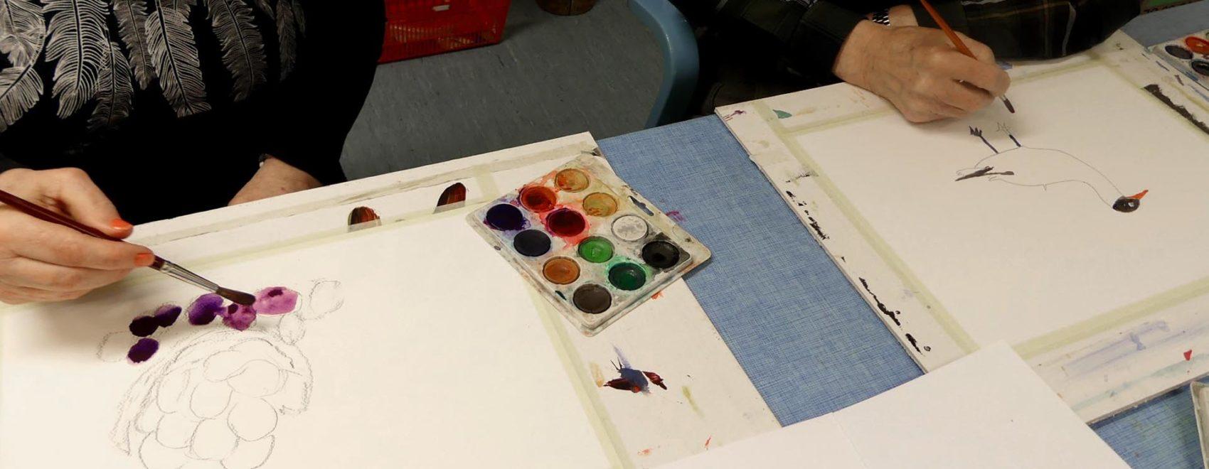 åvikin asukkaita maalaamassa